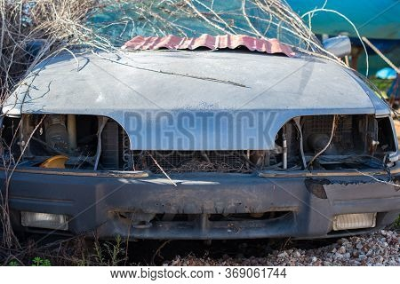 Abandoned Old Car In A Junkyard. Front View