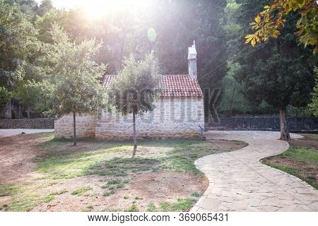 Old Stone House In Croatia. The Path To The House. The Architectural Style Of The Croatian Resort To