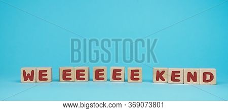 Word Weekend Written On Wood Block. Have A Wonderful Weekend Text On Blue Background