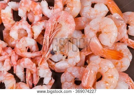Cooked Peeled Shrimps Tails Of Two Varieties - King Prawns And Usual Shrimps On The Brown Dish, Frag