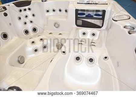 A Close Up On A White Acrylic Hot Tub, Spa Tub, Whirlpool, Showing Vents, Stainless Steel Jets For W
