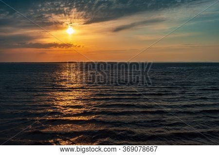 Sunset Over A Big Lake, Sunset Going In A Big Lake With Yellow Sky And Water All Over The Place