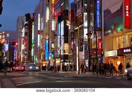 Tokyo, Japan - November 30, 2016: People Walk Under The Neon Lights Of Shinjuku District Of Tokyo, J