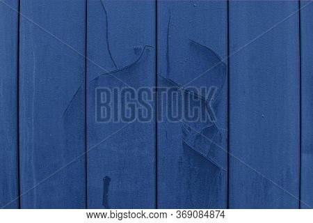 Old Wall Covering, Metal Plates. Classic Blue Siding With Cracked Paint And Dents. Backdrop Backgrou