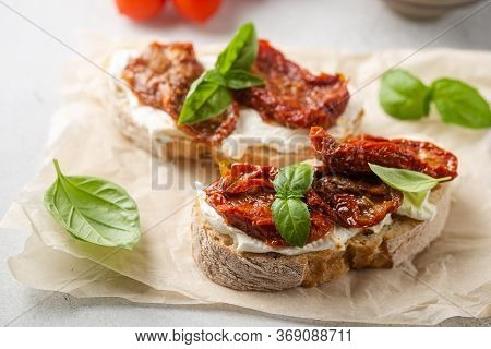 Bruschetta With Sundried Tomatoes, Cottage Cheese And Fresh Basil. Tasty Savory Italian Appetizers