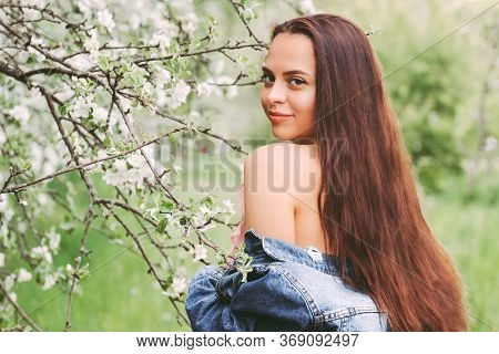 Portrait Beautiful Happy Hipster Girl With Long Hair Posing On Green Meadow And Smile. Young Gentle