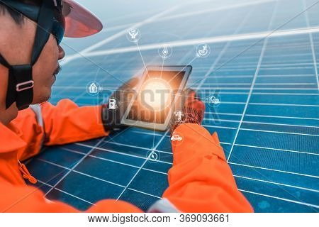The Solar Farm(solar Panel) With Engineers Is Checking The Operation Of The System By Laptop, Altern