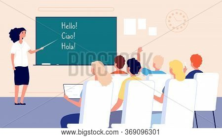 Language Lesson. Students At School, Classroom And Teacher At Chalkboard. Adults Learn Foreign Langu