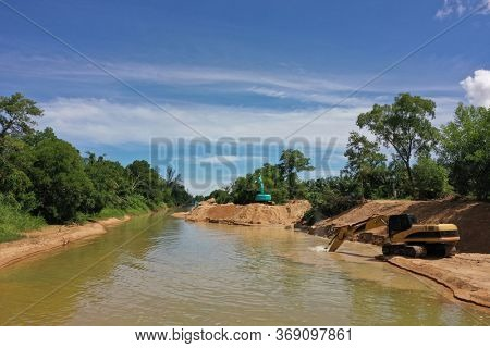 TAKUAPA, THAILAND - 30 MAY 2020: Environmental conservation issue. Machinery mining river, causing siltation and pollution
