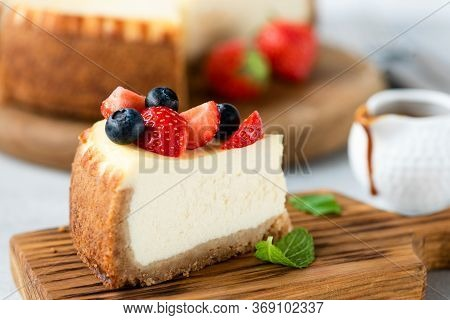 Cheesecake Slice With Summer Berries On Top. Slice Of New York Cheesecake Served With Berries
