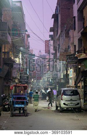Delhi, India - December 05, 2019: Street At Main Bazaar In Paharganj District At Early Morning.