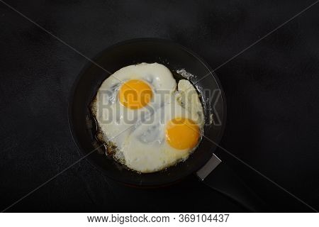 Two Fried Eggs In Cast Iron Frying Pan Healthy Easy Breakfast On A Table. Fresh Homemade Meal On A F