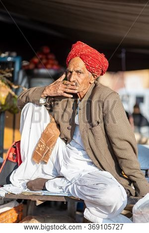 Jaisalmer, India - December 7, 2019: Portrait Of An Elderly Rajasthani Man In Tradional Clothes.