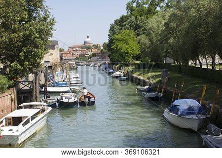 Venice, Italy - May 28 2016: Rio Dei Giardini In Venice, Traditional Canal That Surrounds Venice Pub