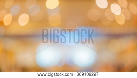 Abstract blur of wedding party in large hall