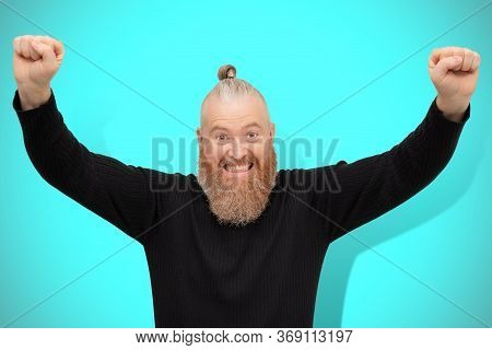 Lucky Excited Man Celebrating Victory Isolated On Blue Background. Overjoyed Bearded Guy Motivated B