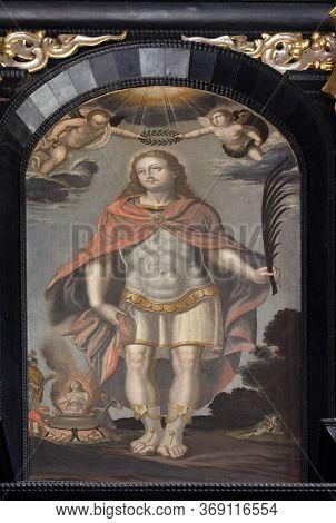 ZAGREB, CROATIA - SEPTEMBER 26, 2018: Saint Vitus, altar of Saint Dionysius in the Church of Saint Catherine of Alexandria in Zagreb, Croatia