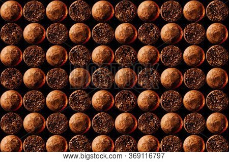 Cuban Cigars Look In Front And Behind A Close-up Pattern. The Concept Of The Background, Horizontal