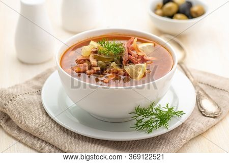 Meat Soup With Vegetables And Olives. Traditional Dish Of Russian Cuisine