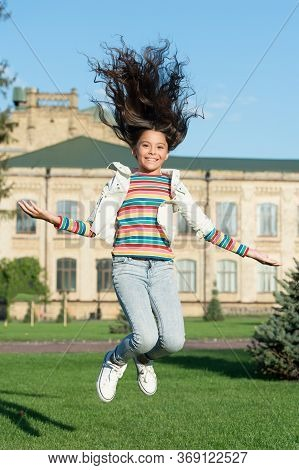 Real Happiness. Add Move To Your Life. Happy Kid Jumping High. Sense Of Freedom. Childhood Happiness
