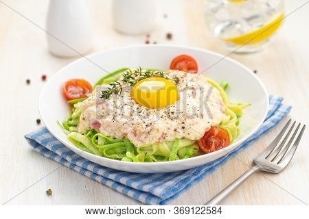Traditional Dish Of Italian Cuisine Carbonara Sauce With Low-carb Zucchini Paste And Egg Yolk. Large
