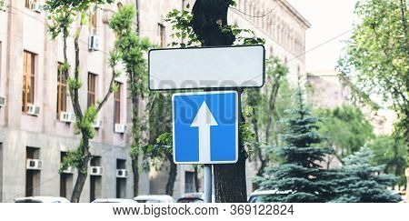 One-way Traffic Sign.road Sign With An Arrow On A Blue Background.