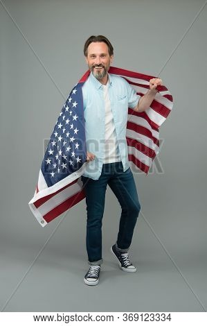 Immigration To Usa. Mature Man Hold Us Flag. Visa For Immigration Travel. American Green Card. Unite