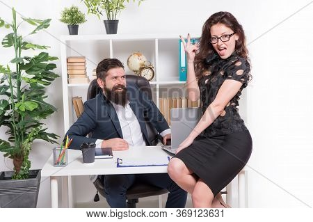 Getting Better All The Time. Happy Woman Show Victory Sign In Office. Business Couple Celebrate Grea