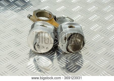 Old Car Engine Piston On The Metal Workbench Background With Copy Space.