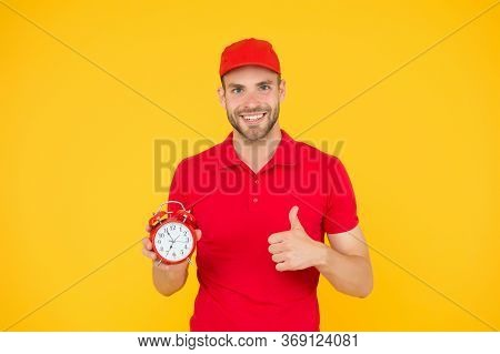Promptness And Punctuality. Delivery Time. Delivery Courier With Clock. Delivery Man Holding Clock.