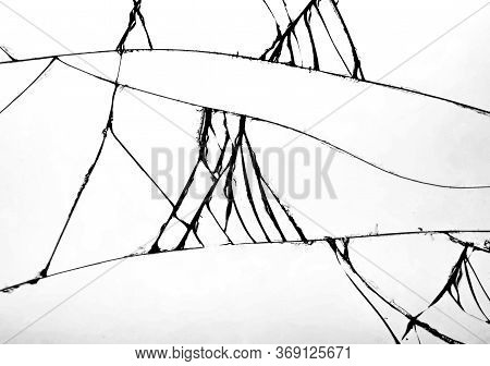 Several Cracks In The Glass That Shattered On The Windshield Of The Car. Concept Of Cracked Glass On