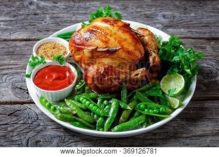 Rotisserie Chicken Served With Fried Pods Of Green Peas, Fresh Green Onion, Parsley, Lime, Tomato Sa