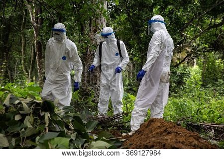 Lunsar, Sierra Leone, June 24, 2015: The Burial Team Disinfects And Prepare To Burn Used Equipment.