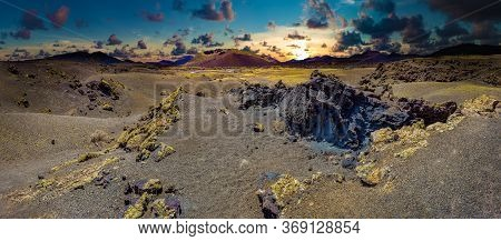 Scenery Mountains,volcanoes And Craters In Wild Landscape.volcanic Landscape At Timanfaya National P