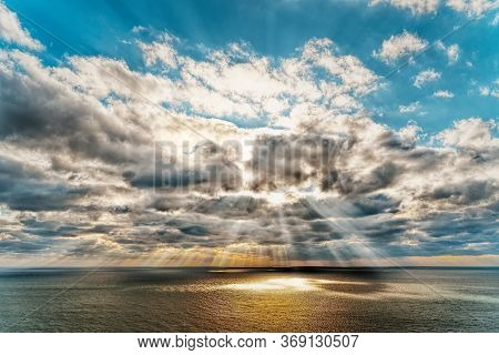 Beautiful Sunset Over The Sea With Reflection In The Water, Majestic Clouds In The Sky. Golden Sun-t