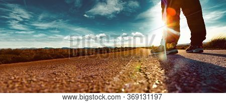 Adventur Lifestyle And Extreme Travel Road Vacations.travel Man Tourist Alone On The Road And Sunset