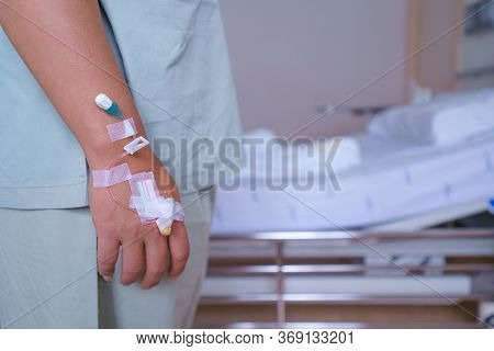 Patients Man Quotes In Hospital Standing By The Bed Of A Ill Sick Person, Patient Rests And Saline S