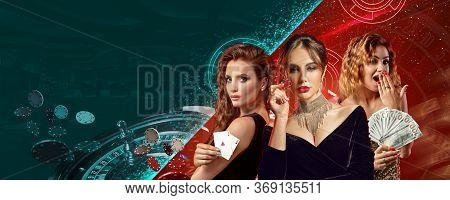 Women In Stylish Dresses Showing Chips, Money And Playing Cards. They Posing On Colorful Background