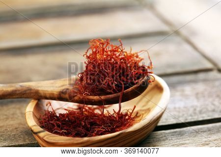 Kesar, Saffron, Crocus Sativus On Rustic Table, Pile Of Saffron