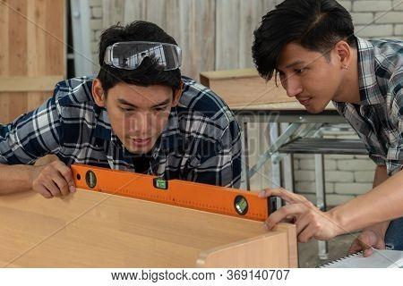 Carpenter Working On Wood Craft At Workshop
