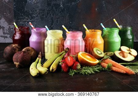 Multicolored Smoothies And Juices From Vegetables, Greens, Fruits And Berries, Food Background. Deto