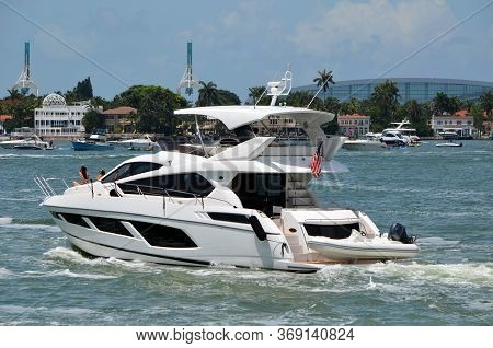 Chartered Luxury Motor Yacht Cruising The Florida Intra-coasstaal Waterway Off Of Miami Beach On A S