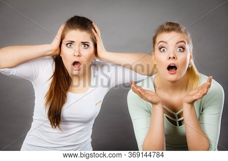 Shock Face Expressions Concept. Closeup Of Two Shocked And Amazed Women Seeing Something Weird.