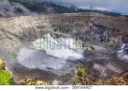 Poas Volcano Crater In Costa Rica, Central America. Active Volcano. A Brief Volcano Spews White Smok