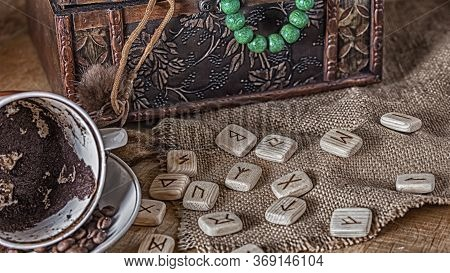 Isoteric Concept Of Divination And Prediction. Runes, Coffee Grounds In A Cup, Rosary On A Table Aga