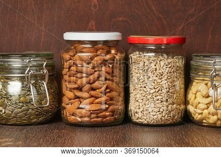 Nuts and seeds in jars in the pantry