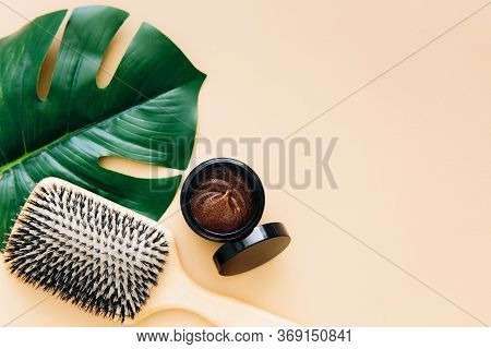 Hair Care Concept. Wooden Hair Brush And Natural Hair Mask Lie On Beige Background. Spa Hair Care.