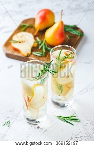 Summer Drinks, Rosemary Pear Cocktails With Ice In Glasses. Refreshing Summer Homemade Alcoholic Or