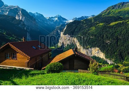 Cozy Wooden Lodges With Amazing Views From The Wengen Mountain Resort. Lauterbrunnen Valley And Moun