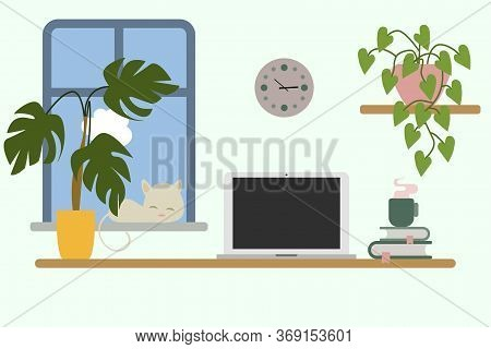 Interior Of A Working Office: Laptop, Plant, Cat, Book, Coffee. A Cozy Workplace. Nice View Of The W